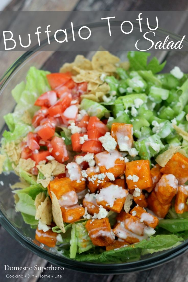 Buffalo Tofu Salad - Crispy tofu covered in buffalo sauce and topped with creamy bleu cheese crumbles and dressing. Love this!