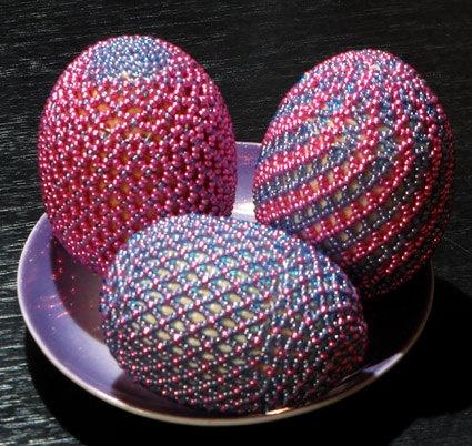 Open net beading on eggs in tones of pinks & blues.