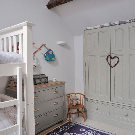 A worn-out cupboard and chest of drawers are given an update with a lick of paint. The purple mat is made from recycled plastic - practical for a kid's room.