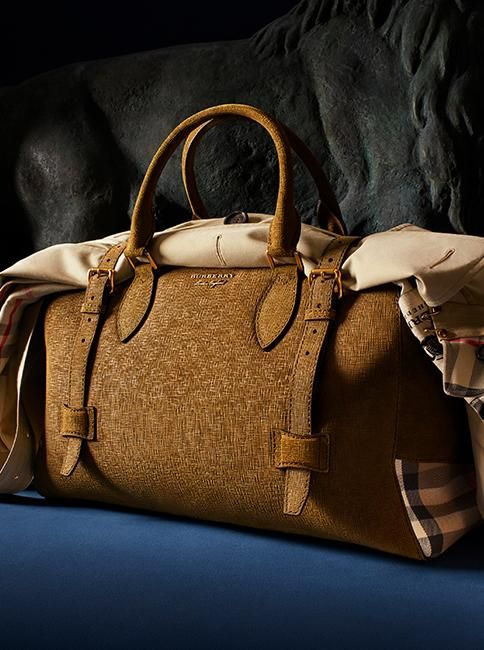 Our new Burberry holdall is crafted from textured suede and detailed with English-woven house check side panels.