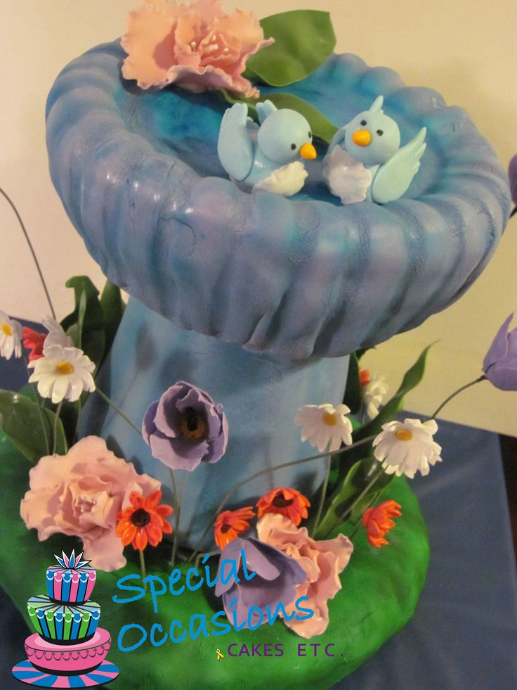 I loved making this bird bath cake!  It is one of my all time favourites.  I used the concrete, acid stained bird bath I made (that sits in my garden) as inspiration.  This was also the first cake I ever assembled on site.  Stressful!!!  LOL