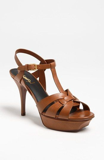 Saint Laurent 'Tribute' T-Strap Sandal, 2009-2014 reeditions of 1971 Yves Saint Laurent collection. Available this season at #Nordstrom. Price has not come down ($875). Seems they will never be on sale. Comfy, super elegant. Perfect. History on PureTrend : http://www.puretrend.com/rubrique/histoire-de-la-mode_r16/sandale-tribute-to-lucienne-and-yves_a32874/1