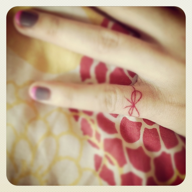 red string finger tattoo