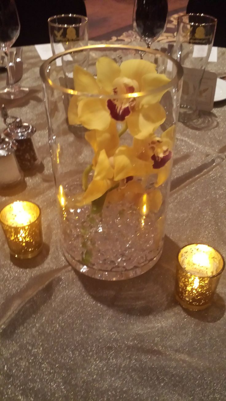 37 best centerpieces images on pinterest center pieces yellow orchids inside a clear cylinder vase with clear gel beads and battery operated candles reviewsmspy