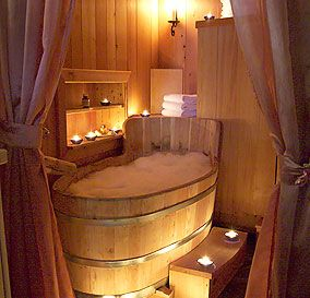 Lovely, small, deep, wooden tub. Love all the candles. | Tiny Homes