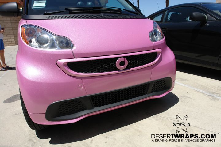Vibrant and eye catching. DesertWraps.com located in Palm Desert, CA wrapped this Smart Car in high quality and long lasting vinyl wrap. Call DesertWraps.com at 760-935-3600. #SmartCar #PinkCarWrap #PinkWrap #VehicleWrap #CarWrap #PalmDesert #PalmSprings #Indio #CathedralCity