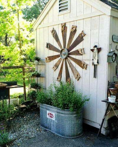 ~ do in form of a clock on the side of the barn . maybe use a lightweight tool as the hand ~ Gail ... old saws against the shed