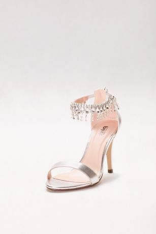 """Luxurious dripping crystals give these strappy heels the feel of fine jewelry.   By Pink Paradox  Synthetic  Back zipper  3"""" heel  Imported"""