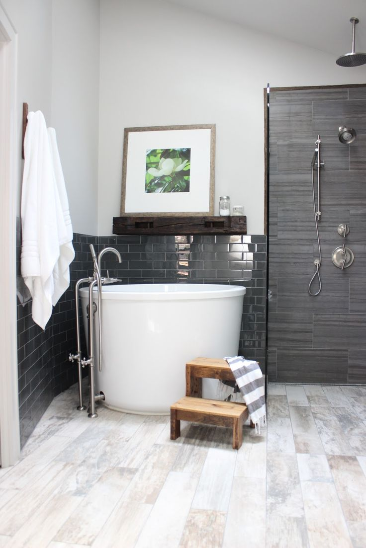 This bathroom by Design Indulgence incorporates a Japanese soaking tub in a corner, and fits nicely alongside a traditional shower stall