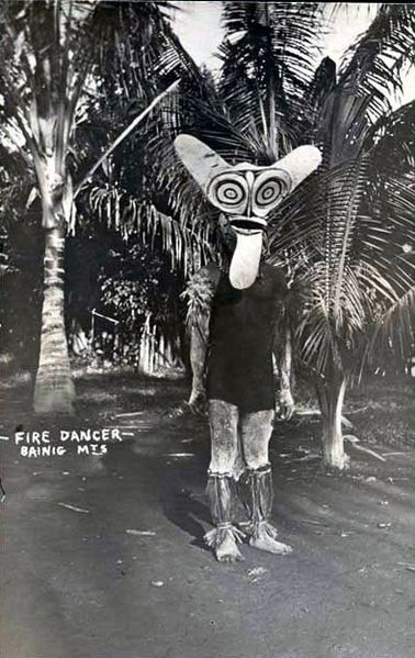celia-hannes:  Firedancer from the Baining people wearing a ceremonial mask, Gazelle Peninsula of New Britain, Papua New Guinea. Real photo postcard from the 1910s.