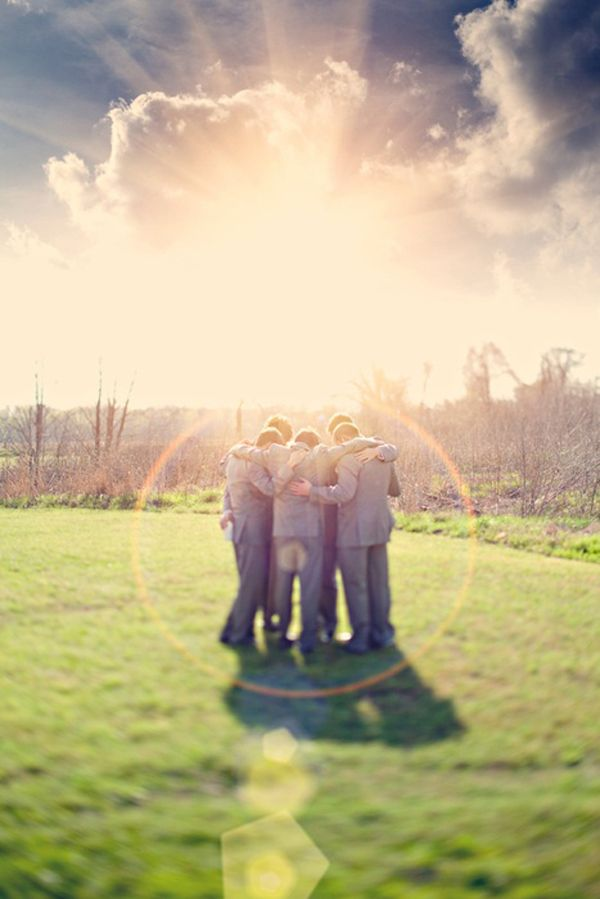 Groomsmen praying before the wedding. {I SO want a picture like this of the guys in my wedding - and a matching one of us ladies!}