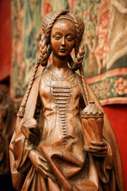 site:	National Museum of the Middle Ages, Paris title:	Saint Mary Magdalene caption:	A beautiful wood-carved statue of Saint Mary Magdalene from Brussels, c.1566. keywords:	belgian, brussels, c16, cluny museum, france, hotel de cluny, mary magdalene, medieval, middle ages, moyen age, musee, musee de cluny, museum, paris, renaissance, saint, sculpture, statue, wood, year1566
