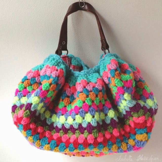 This seems to be made from a large granny square gathered in at the top with a shell edging - quite a few pictures showing the top and lining - by isabellekessedjian