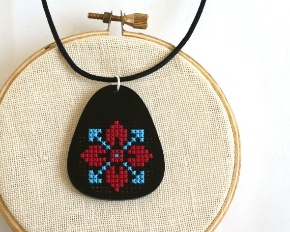 Modern Cross Stitch Necklace, Black Acrylic with Red and Turquoise Folk Art Design. $45.00, via Etsy.