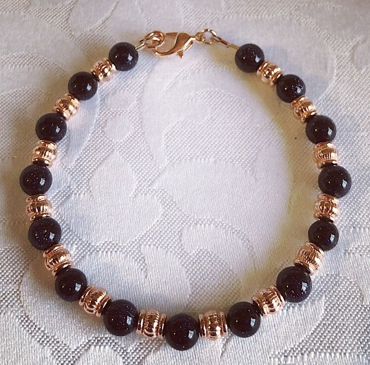 A personal favourite from my Etsy shop https://www.etsy.com/uk/listing/601145051/blue-sandstone-and-rose-gold-bead