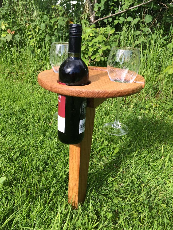 "Personalised Folding Wine Table: It folds up and has a built in handle for carrying. Insert the pointed peg into the ground. Fold the table top over on its wooden hinge. Then, enjoy a nice bottle of wine without concern of where to set your wine bottle or tipping over your glasses. This solid oak table is 12""(30 cm) in diameter and has more than enough room for light snacks. Price includes engraving and delivery to Ireland & United Kingdom."