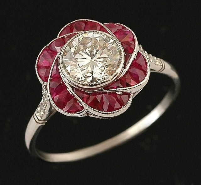 An Art Deco style diamond and ruby ring, of floral cluster…