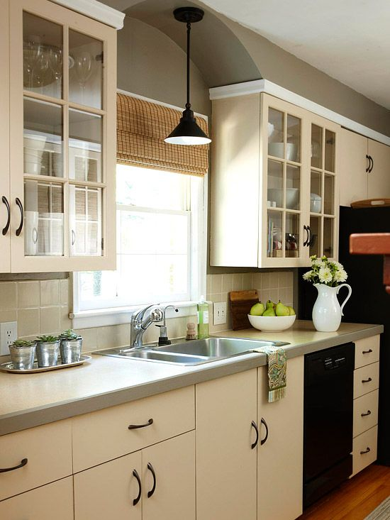 Gorgeous Galley Kitchen - hanging light over sink, new stainless steel sink, new open glass cabinet doors. Edging on laminate countertops.
