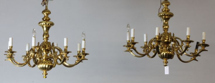 "A pair of Dutch style 8 branch chandeliers with reede baluster stems, scrolled branches and dish sconces, 28""h x 31 1/2"" diam., est £300-500"