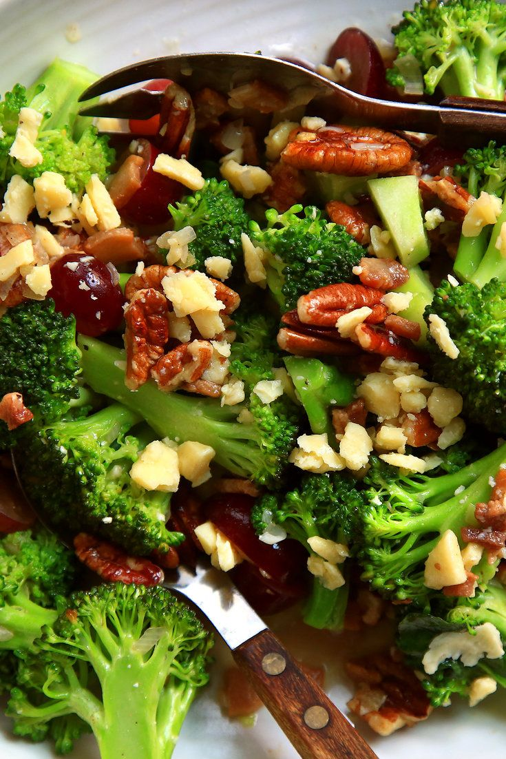 "Broccoli salads are a dime a dozen, but this one, which is adapted from Ashley Christensen's cookbook, ""Poole's: Recipes from a Modern Diner,"" is a game-changing celebration of flavors, colors and textures: broccoli, toasted pecans and red grapes are cloaked in a warm bacon-scallion vinaigrette, then sprinkled with small chunks of sharp white Cheddar. (Photo: Jim Wilson/NYT)"