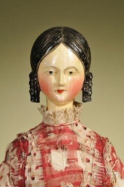 Large Grodnertal wooden Lady, 19th century, carved hair with center part, ringlets to the sides and coiled bun, finely brush-stroked brows and lashes, blue eyes and pursed red lips, all wood body jointed arms at shoulders, elbows, hips and knees, with red and black printed gauze dress and cotton under-slip, feet with red painted shoes.