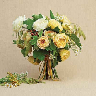 Indian Summer Bouquet | Inspired by the warm days in early autumn, garden roses, chamomile, cranberry virburnum, and wild grasses and oats come together with a vintage mustard-colored, velvet ribbon. | SouthernLiving.com