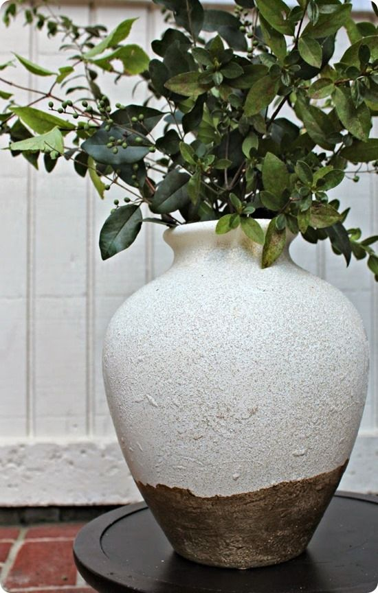 This old vase got a Pottery Barn inspired Tuscan makeover with paint. Just check out the texture from the stone spray paint!