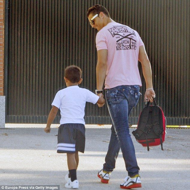 Doting dad: Footballer Cristiano Ronaldo brought his adorable four-year-old son Cristiano ...