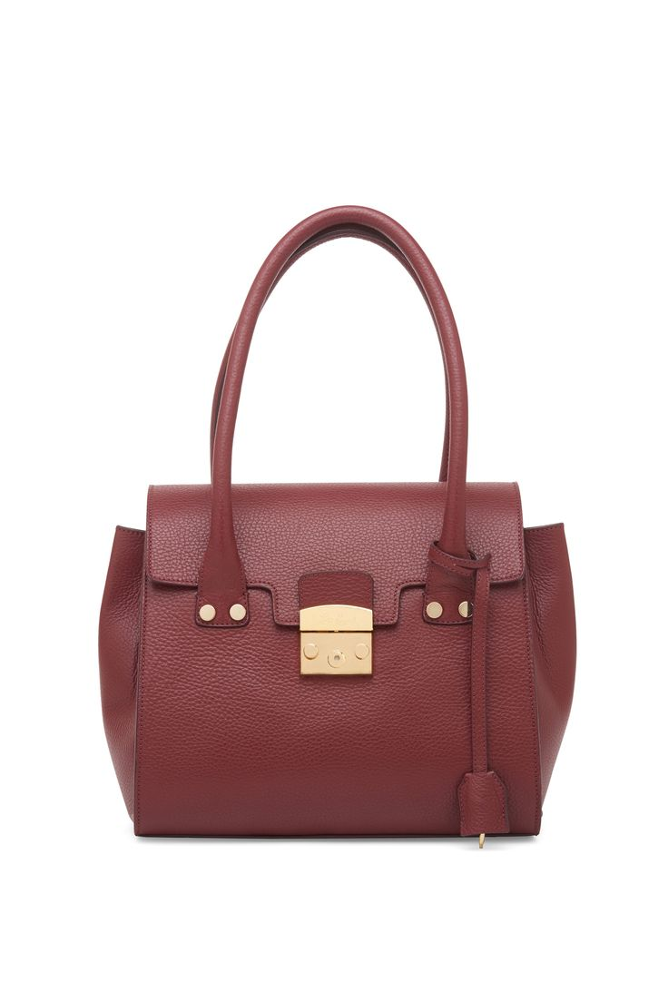 Leather bag with snap closure and attached key