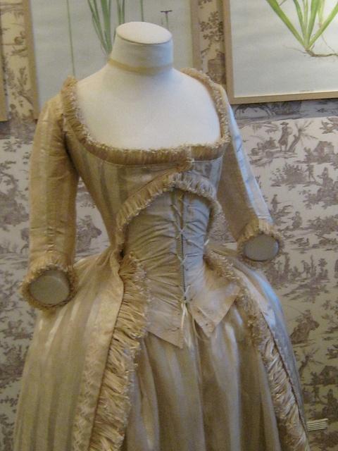 Cutaway gown, possibly a robe à la polonaise longue.