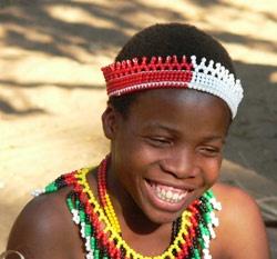Young Zulu girl wearing traditional beadwork.