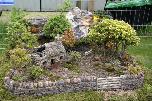 Miniature Bonsai garden. The falling down house makes this amazing.