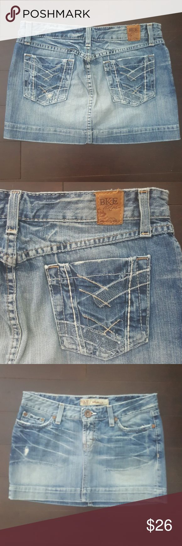 """BKE denim STARLITE distressed jean skirt size 27 BKE denim from The Buckle, distressed Starlite skirt in size 27.  10 1/2"""" front length and 13"""" back length.  Reasonable offers always welcome! BKE Skirts"""