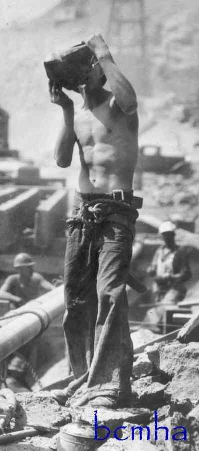 Worker takes a water break, repinned from Hoover Dam.