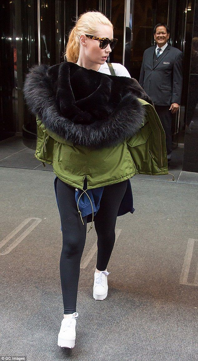 Always unique: Iggy Azalea stepped out in New York on Thursday looking somewhat strange, as she decided to wear her jacket backwards