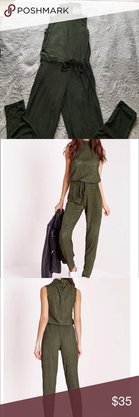 roll neck skinny rib jumpsuit khaki work some major cool day vibes this season in this seriously standout green jumpsuit. in an on point ribbed style this roll neck number with tie waist feature will give you a killer silhouette. team with casual trainers and shoulder bag for an effortlessly styled day look.    P.S has very small slit in the left side of the leg that can easily be sown. I'll attach a picture as well Misguided Other