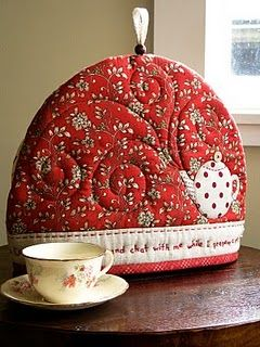 "At the bottom of this tea cozy, there is stitched ""Come into my kitchen and chat with me while I prepare a pot of tea"""