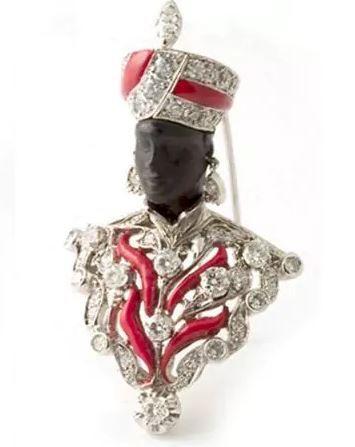Black figure brooch