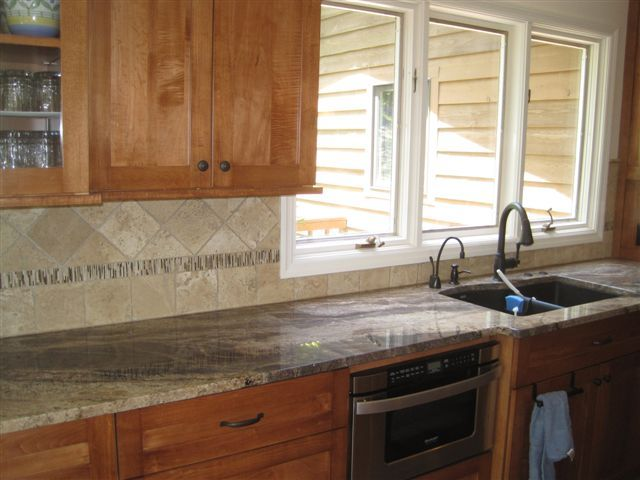 Golden Thunder Granite Counters With Natural Cherry Light