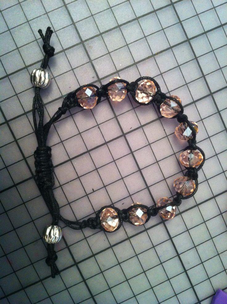Shamballa bracelet, pink glass beads on black twine finished with silver beads.