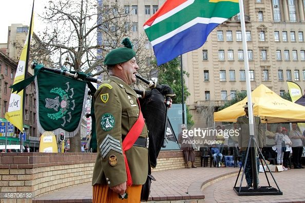 A member of the South African Irish Regiment plays the bagpipes at the Cenotaph to commemorate the lives lost during the the World Wars I and II, and the other wars, in central Johannesburg, South...