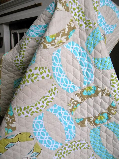 Baby Girl Quilt    Made this baby girl quilt for my friend who's soon to have a baby. I made the basic oval using the Quick Curve Ruler and then alternated them, added a small border.    sewkindofwonderful.blogspot.com/2012/01/baby-girl-quilt.html