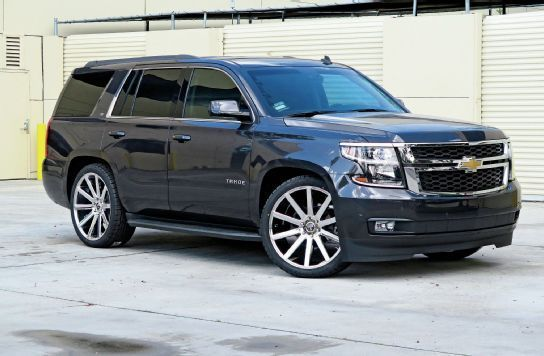 One of our favorites!  A 2016 Tahoe with 24-inch wheels and a lowering kit.  Looks much more aggressive and stylish.