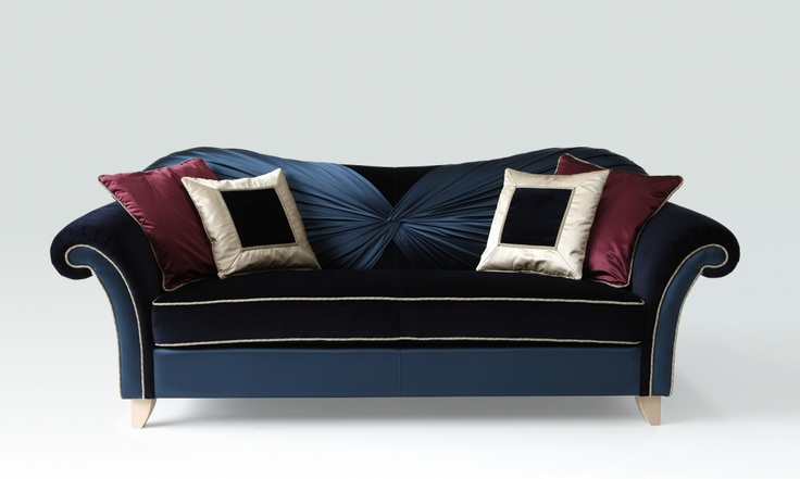 Liviane sofa. Design meets fashion: beautifully draped haute couture dresses inspired in the new sofa Liviane Couture, where the warmth of velvet, the brightness of satin, the charm of the silhoutte merge into the elegant equilibrium suggested by the blue, the colour of royalty, luxury and perfection.  ARTEX Design Lab