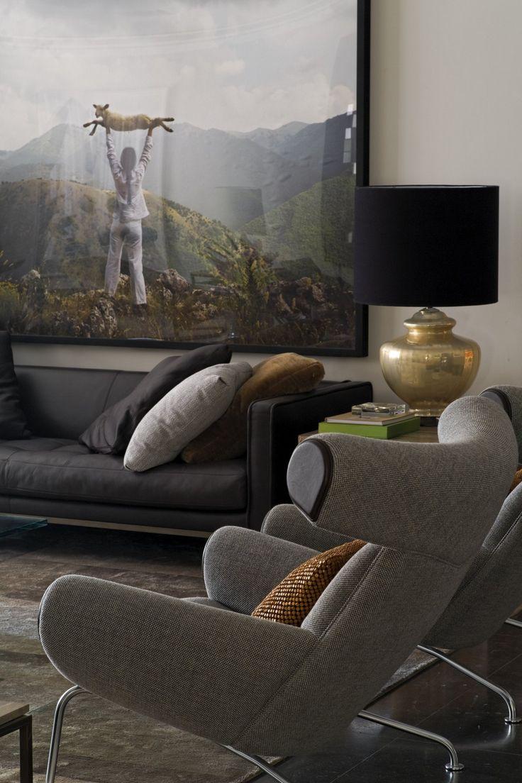 brass lamp w/ black shade, grey ox chair w/ blk-ish sofa