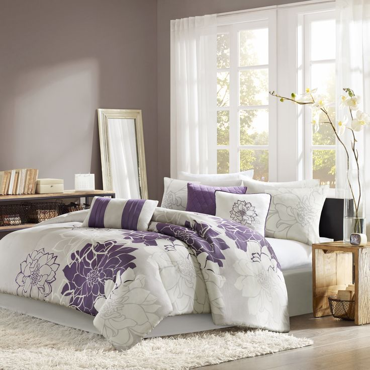 This seven-piece floral comforter set gives your bedroom cozy charm. This white and purple floral set includes a comforter, a bedskirt, two pillowshams, and three pillows. It has everything you need to make dressing up your bedroom easy and convenient.