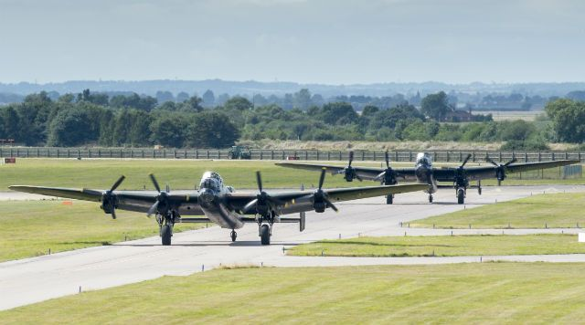 Two Avro Lancaster bombers have flown in formation for the first time in more than 50 years
