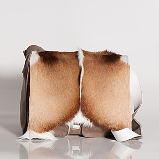 Beautiful and oh so practical to carry your ipad, iphone, sunglasses, lipstick etc etc etc ...