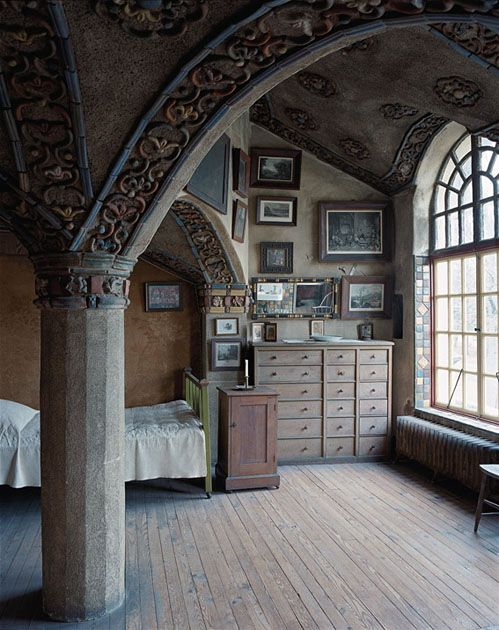 "Henry Chapman Mercer, Ceramicist, Fonthill, Doylestown, Pennsylvania. One of seven bedrooms and nine ""chambers,"" each of which is unique, the Dormer Room was Mercer's original bedroom. The dresser on the right was designed by Mercer for the room, and the pictures above it are from his extensive collection of prints, more than one thousand of which hang on the walls of Fonthill."