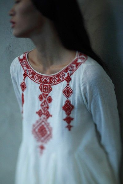 White shirt with powerful red embroidery.